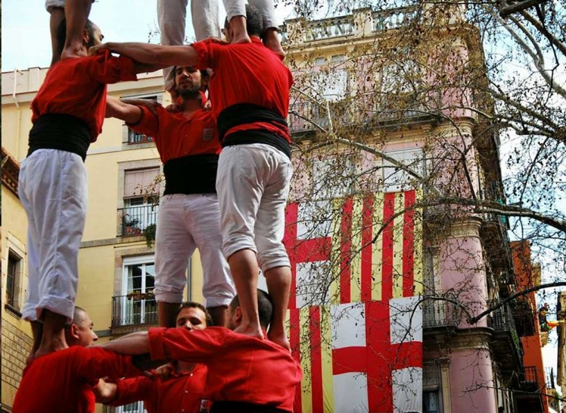 Castellers next to the flag