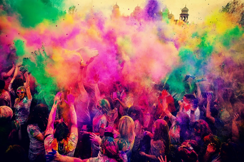 Bright colours being sprayed at Holi Festival