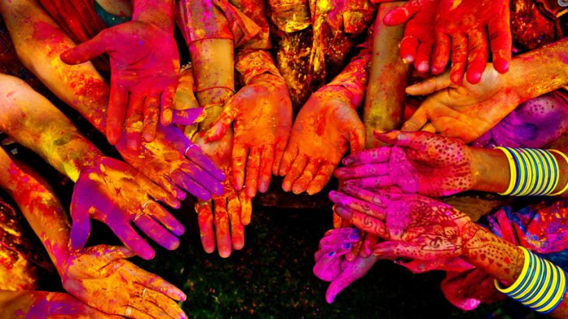 Hands covered in colour makes everyone look the same