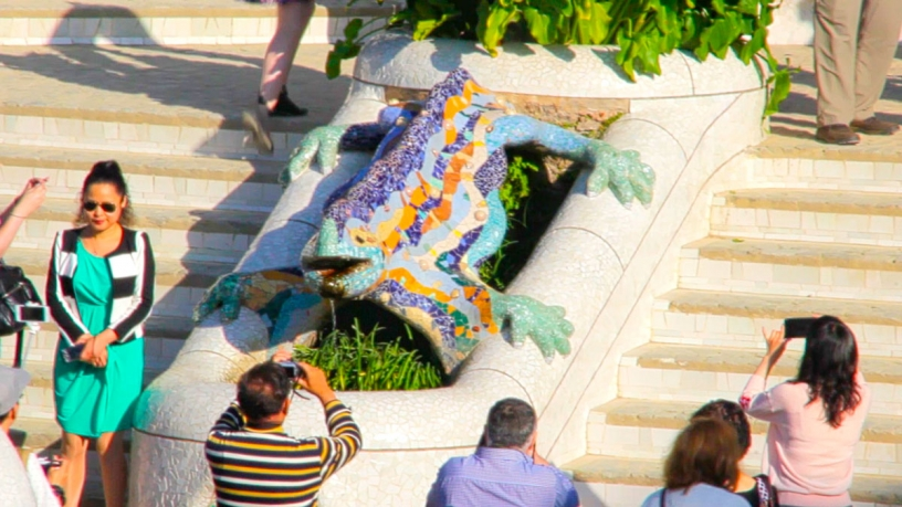 Tourists photographing the salamander of Park Güell