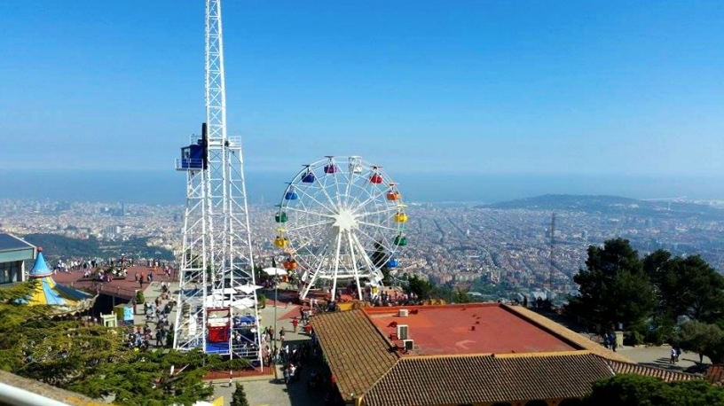 View on attractions and Barcelona from Tibidabo