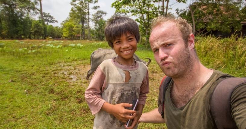 Brendan meeting a local child in Cambodia