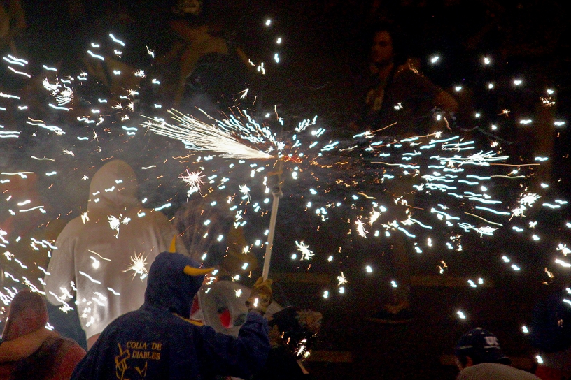 A Catalan Diable, mesmerizing a crowd at a Correfoc