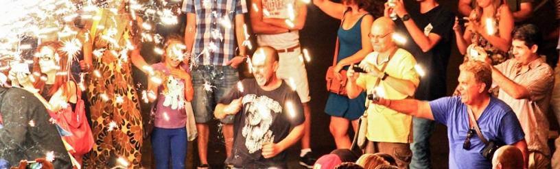 Spectator dancing at a Correfoc