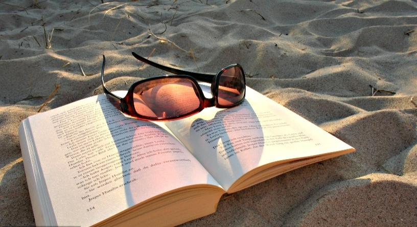 Read on the Barcelona's beach