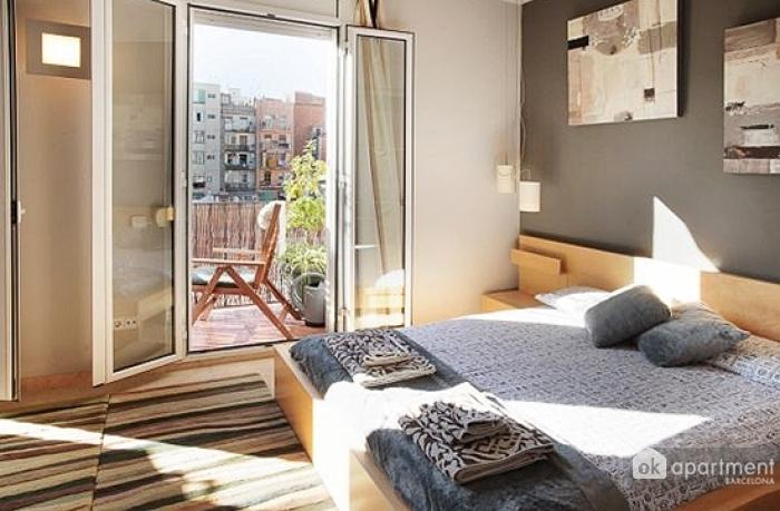 Double bed en balkon