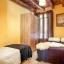 Tweede slaapkamer met tweepersoonsbed en een bed