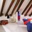 Habitación doble con vigas de madera rústicas