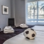 Twin bedroom with football decor