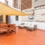 Large terrace with table and sofa