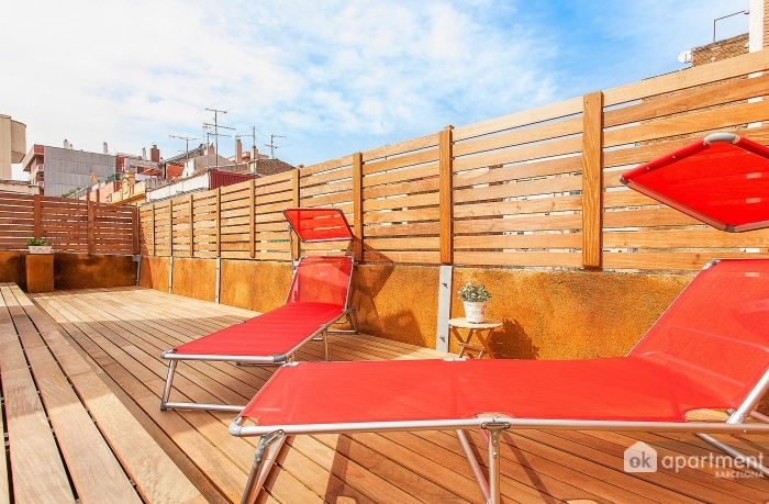 Community terrace with sun loungers